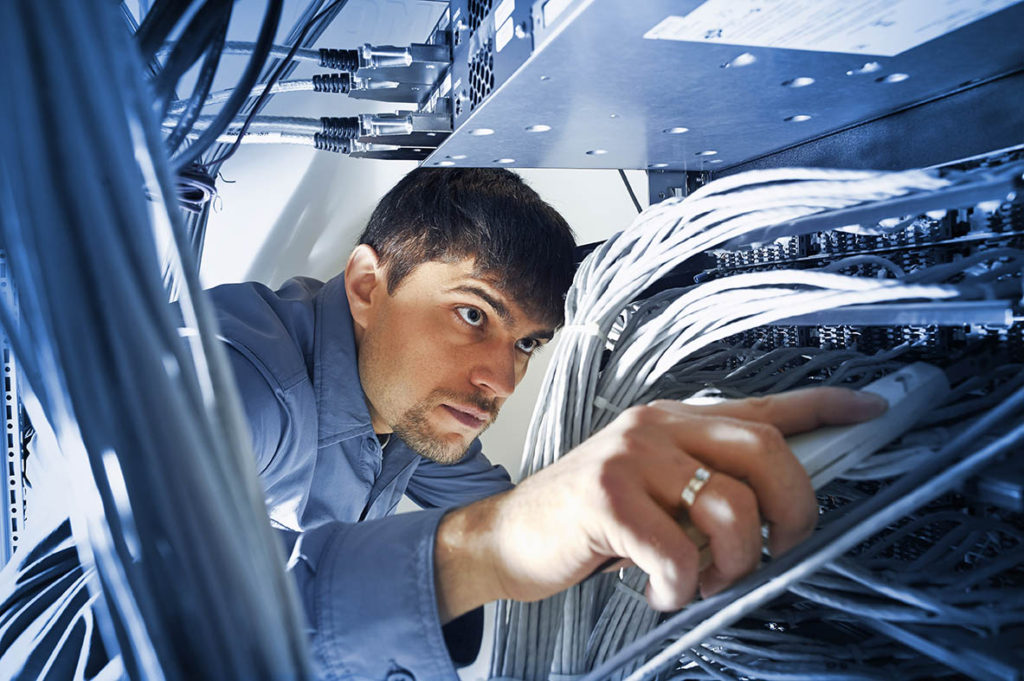 Technician engeneer is checking server's wires in data center